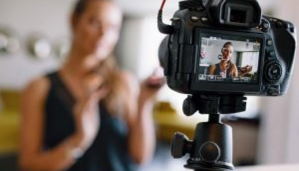 young-female-vlogger-recording-a-make-up-video-for-her-vlog